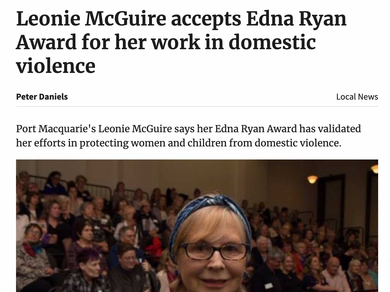 Article headline: Leonie McGuire accepts Edna Ryan Award for her work in domestic violence